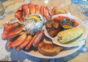 A platter of food including corn and seafood