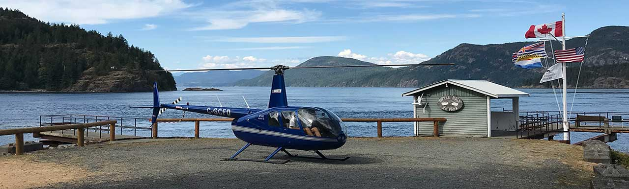 Helicopter in front of lake
